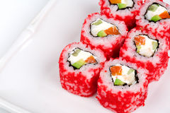 Sushi roll with salmon, crab, shrimps and caviar. Close up of Sushi roll with salmon, crab, shrimps and caviar Royalty Free Stock Images