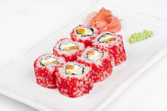 Sushi roll with salmon, crab, shrimps and caviar. On plate Stock Image