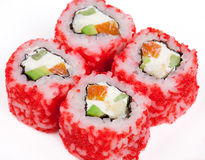 Sushi roll with salmon, crab, shrimps and caviar. On the plate Stock Photography