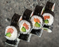 Sushi roll with salmon, cream cheese and avocado Stock Image