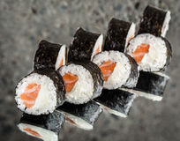 Sushi roll with salmon and cream cheese Royalty Free Stock Photography