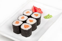 Sushi roll with salmon. Sushi roll with salmon and ginger Royalty Free Stock Photos