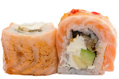 Sushi roll with salmon isolated on white background. Sushi roll with grilled salmon isolated on white background Stock Images