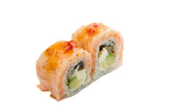 Sushi roll with salmon isolated on white background. Sushi roll with grilled salmon isolated on white background Royalty Free Stock Photos