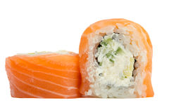 Sushi roll with salmon isolated on white background. Sushi roll philadelphia with salmon isolated on white background Royalty Free Stock Photos