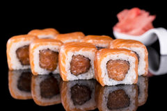 Sushi Roll with salmon over  black background with reflection Stock Image