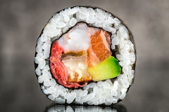 Sushi roll with salmon, shrimps and avocado Stock Image