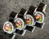 Sushi roll with salmon, shrimps and avocado Royalty Free Stock Photos