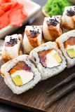 Sushi roll with salmon, tuna and eel Royalty Free Stock Photo