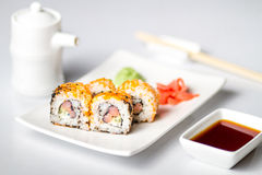 Sushi roll with salmon, wasabi and ginger. royalty free stock photo