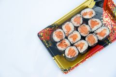 Sushi Roll with salmon on the white background .Food abstract background.  stock images