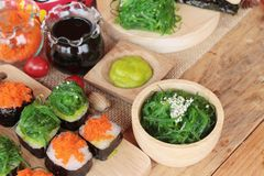 Sushi roll with seaweed salad and shrimp eggs. Stock Image