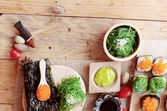 Sushi roll with seaweed salad and shrimp eggs. Stock Photography