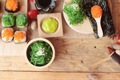 Sushi roll with seaweed salad and shrimp eggs. Stock Photos