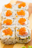 Sushi roll with sesame and caviar Royalty Free Stock Photography