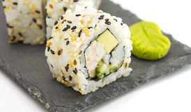 Sushi roll with sesame on a stone plate isolated Stock Photography