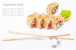Sushi roll with sesame, sweet pepper, cucumber. Wasabi and place for text Royalty Free Stock Photos