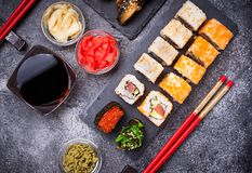Sushi and roll set on black table stock photos