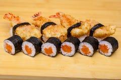 Sushi roll set with ebi tempura shrimp on wooden background Stock Image