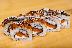 Sushi roll set with eel and salmon on wooden background Royalty Free Stock Photography