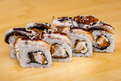 Sushi roll set with eel on wooden background Royalty Free Stock Images