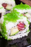 Sushi roll set in green caviar Stock Photography