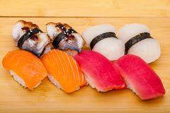 Sushi roll set mix on wooden background Royalty Free Stock Images