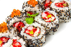 Sushi roll with shrimp, flying fish roe, salmon and black sesame Royalty Free Stock Image