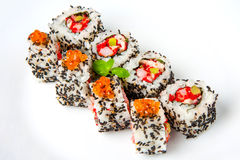 Sushi roll with shrimp, flying fish roe, salmon and black sesame Stock Photo