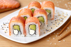 Sushi roll with smoked salmon, avocado, soft Stock Image