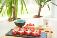 Sushi roll sushi with fish, cream cheese and vegetables. Sushi menu. Japanese food Stock Image