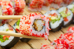 Sushi roll in tempura and red tobiko Stock Photo