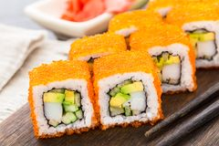 Sushi roll with tobico and avocado Stock Photo