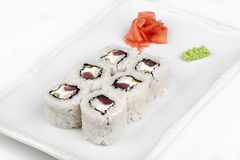 Sushi roll with tuna and salmon. Sushi roll with tuna and salmon on the plate Stock Images
