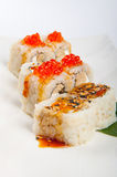 Sushi roll with tuna, scrambled eggs, cream cheese and red caviar Royalty Free Stock Image