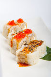 Sushi roll with tuna, scrambled eggs, cream cheese and red caviar Royalty Free Stock Photo