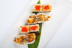 Sushi roll with tuna, scrambled eggs, cream cheese and red caviar Stock Photos