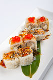 Sushi roll with tuna, scrambled eggs, cream cheese and red caviar Royalty Free Stock Photos