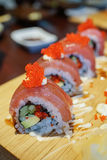 Sushi roll with tuna and tobiko. Stock Photography