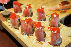 Sushi roll with tuna and tobiko. Stock Photos