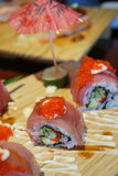 Sushi roll with tuna and tobiko. Royalty Free Stock Photography