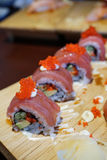Sushi roll with tuna and tobiko. Stock Photo