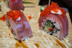 Sushi roll with tuna and tobiko. Royalty Free Stock Photos