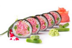 Sushi roll turned on a white background. Sushi Japanese food in a restaurant. Japanese restaurant menu. Unusual pink. Rolls stock photography