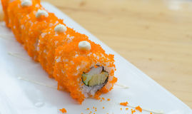 Sushi roll on white plate Stock Images