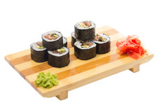 Sushi roll on wooden plate Royalty Free Stock Images