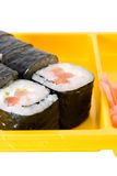 Sushi roll on yellow plate. Isolated close up of sushi roll on yellow plate Royalty Free Stock Images