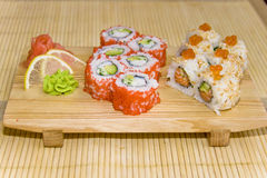 Sushi rolls. Served on a wooden board Stock Photo