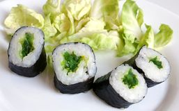 Sushi rolls. On the white plate stock photography