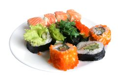 Sushi rolls. On plate isolated on the white background Royalty Free Stock Photos